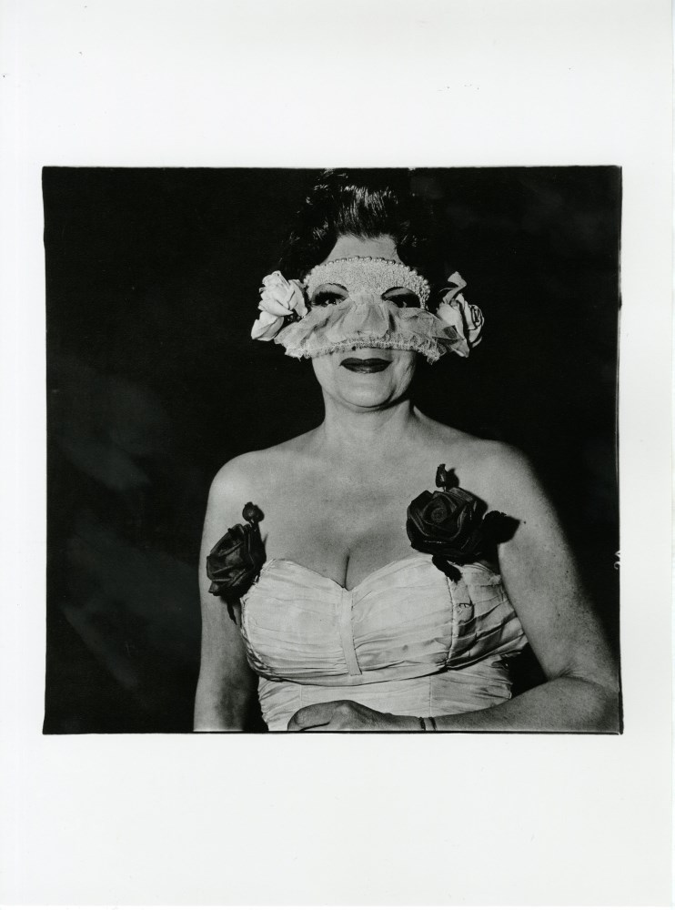 Lot #432: DIANE ARBUS - Lady at a Masked Ball with Two Roses on Her Dress, N.Y.C - Original photogravure