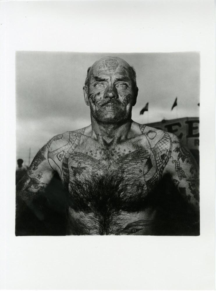 Lot #859: DIANE ARBUS - Tattooed Man at a Carnival, Maryland - Original photogravure