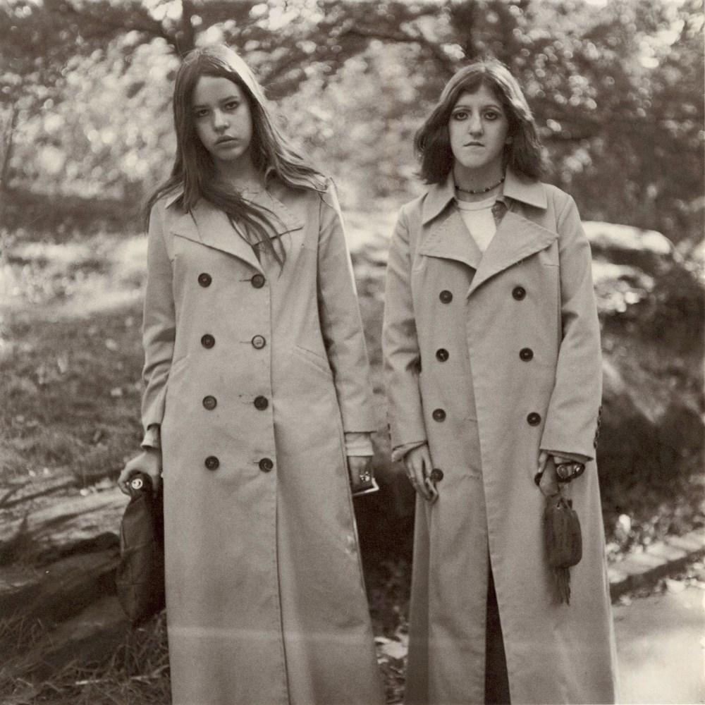 Lot #72: DIANE ARBUS - Two Girls in Identical Raincoats, Central Park, N.Y.C - Original vintage photogravure