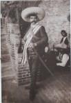 Lot #1304: AGUSTIN VICTOR CASASOLA - Emiliano Zapata, Jefe del Ejercito Suriano, con Rifle y Sable - Gelatin silver print