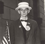 Lot #1412: DIANE ARBUS - Boy with a Straw Hat Waiting to March in a Pro-war Parade, N.Y.C - Original vintage photogravure