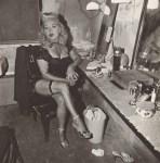 Lot #668: DIANE ARBUS - Burlesque Comedienne in Her Dressing Room, Atlantic City, N.J - Original vintage photogravure
