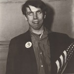 Lot #266: DIANE ARBUS - Patriotic Young Man with a Flag, N.Y.C - Original vintage photogravure