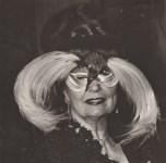 Lot #757: DIANE ARBUS - Woman in a Bird Mask, N.Y.C - Original vintage photogravure
