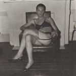 Lot #906: DIANE ARBUS - Seated Man in Bra and Stockings, N.Y.C - Original vintage photogravure