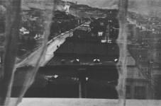 Lot #771: ROBERT FRANK - View from Hotel Window, Butte, Montana - Original photogravure