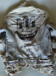Lot #1921: KEITH HARING [imputee] - Levi Jacket drawing: Three Eyed Smiling Face - Black marker drawing on denim textile